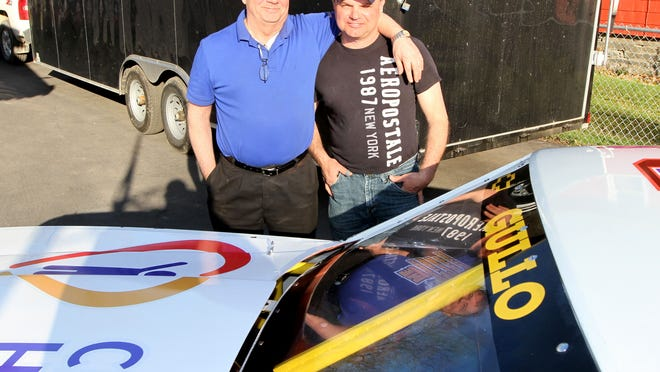 Car owner Ray Marshall, left, and driver Tim Gullo with their Chevy Super Stock at Gullo's home and race shop on Hall Street in Elmira on Wednesday.