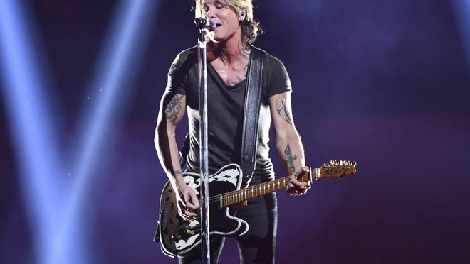 """FILE - This Nov. 14, 2018 file photo shows  Keith Urban performing at the 52nd annual CMA Awards in Nashville, Tenn., in 2018. His latest album, """"The Speed of Now Part 1,"""" came out Friday."""