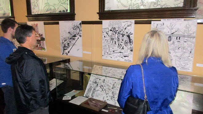 Visitors to the Chenango County Historical Society and Museum in Norwich inspect the exhibit of the art of Danny McCarey in June 2019. CCHS is raising funds through Boscov's annual 'Friends Helping Friends' shopping event, to be held Oct. 14 and 15.