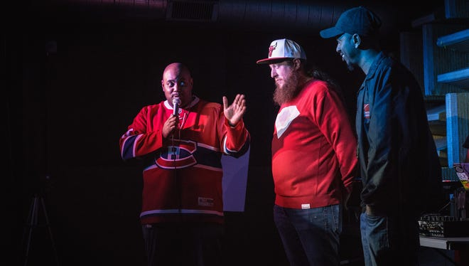 J. Brookinz Battle League host J. Moore, left, introduces competitors Dylan Prevails and Diop at the Hi-Fi.