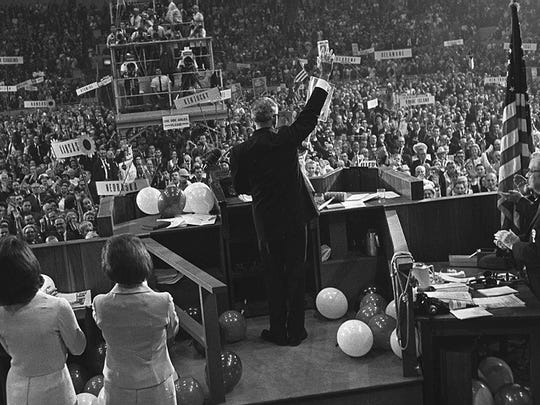 "Barry Goldwater waves to delegates at the Republican National Convention in San Francisco on July 16, 1964. His now-famous nomination speech was punctuated by his statement on extremism: ""I would remind you that extremism in the defense of liberty is no vice,"" Goldwater said. ""And let me remind you also that moderation in the pursuit of justice is no virtue."""