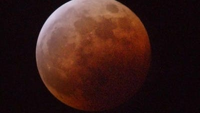 The moon turned red during this total eclipse May 15, 2003. A total lunar eclipse will  begin at 9:07 p.m. Sunday.