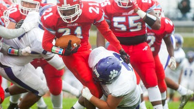 Martin Booker Jr. carries the ball for Pennsauken High School in a September 2016 home game. A referendum proposes upgrades to the school's football field and stadium.