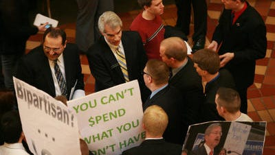 Then-Rep. Jeff Kaufmann R-Wilton, left, and Rep. Kevin Koester R-Ankeny talk with students from Iowa State University at the Capitol during Regents Day in 2011.