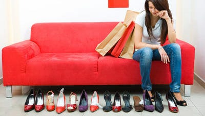 Woman looking at row of shoes.