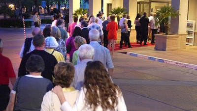 Movie goers line up outside The Camelot for screenings during the 2013 American Documentary Film Festival.