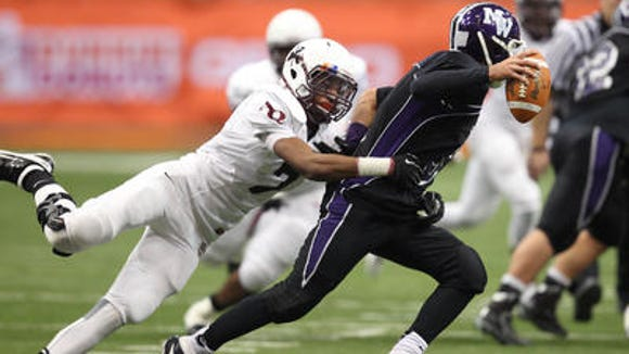 Aquinas senior linebacker Theron Eison, shown here at the 2013 Class AA state championship.