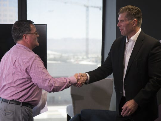 Randy Lovely (left), vice president/community news of the USA TODAY Network, introduces Greg Burton as the new executive editor of The Arizona Republic and azcentral.com on April 23, 2018.
