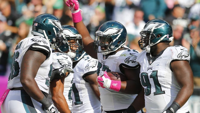 The Eagles' Cedric Thornton reacts with Bennie Logan, Nate Allen and Fletcher Cox after recovering a fumble and scoring a touchdown in the third quarter against the St. Louis Rams on Oct. 5 at Lincoln Financial Field in Philadelphia.