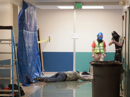 Volunteers helped law enforcement officials as they went through several scenarios during active shooter training at Little Valley Elementary in St. George on Wednesday, June 6, 2018.