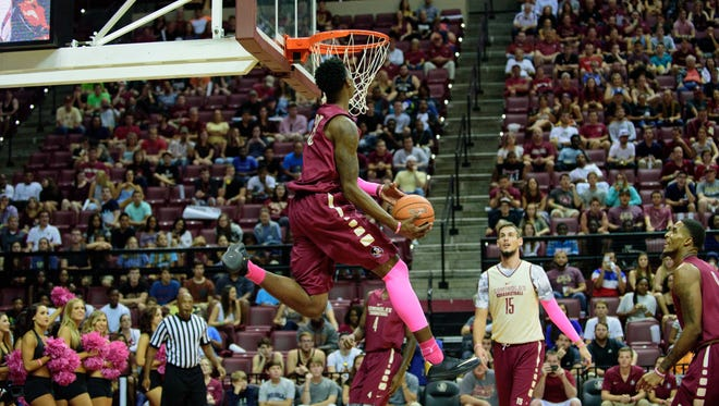Jarquez Smith (23) goes for a slam dunk during the Jam with Ham event, Friday, October 16, 2015 at the Donald L. Tucker Civic Center in Tallahassee, FL.