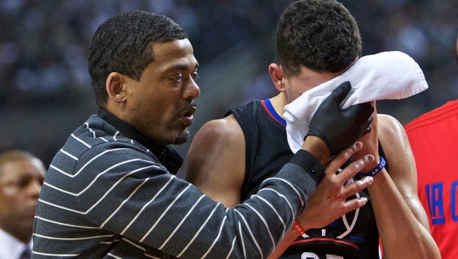 Los Angeles Clippers guard Austin Rivers (25) leaves the court after catching an elbow during the first half of Game 6 vs. the Trail Blazers.