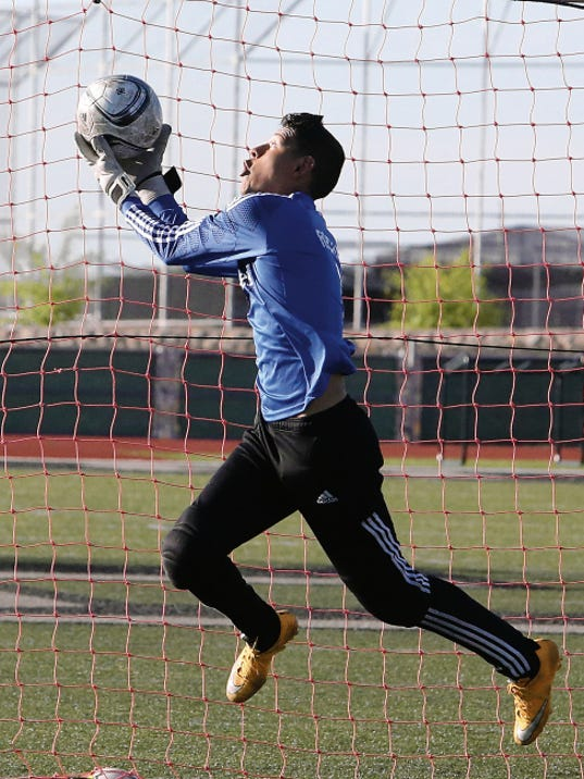 Rudy Gutierrez—El Paso Times Horizon goal keeper Abraham Rocha catches a kick during Tuesday's practice.