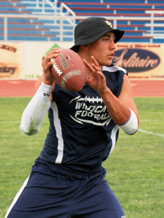 Bill Armendariz - Headlight Photo   Wildcat quarterback Dante Urrea surveys the coverage before delivering a strike to a Deming receiver during Tuesday's 7-on-7 competition at DHS Memorial Stadium. Teams attending the event were Bayard Cobre High, Silver High of Silver City and Hot Springs High of Truth or Consequences.