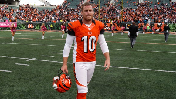Bengals punter Kevin Huber walks off the field after f553c3b619d5