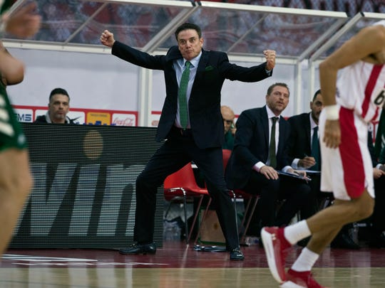 "FILE - In this Jan. 4, 2019, file photo, Panathinaikos coach Rick Pitino reacts during a Euroleague basketball match between Panathinaikos and Olympiakos in Piraeus near Athens, Greece. Greece's government has condemned a walkout by the basketball club Olympiakos during a Greek Cup semifinal game against rival Panathinaikos following complaints over the refereeing. Olympiakos forfeited the game at Olympic Stadium in Athens on Wednesday, Feb. 13, 2019, leaving at halftime and trailing 40-25. A spokesman for the team said he was ""disgusted"" with the quality of the refereeing. The action handed Panathinaikos and American coach Pitino a place in Sunday's cup final against PAOK in Crete. (AP Photo/Petros Giannakouris)"