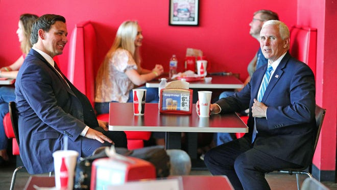 Vice President Mike Pence (right) has lunch with Florida Gov. Ron DeSantis in Orlando, FL, Wednesday, May 20, 2020. Pence and the governor dined at Beth's Burger Bar before heading to a roundtable discussion on the Florida economy.
