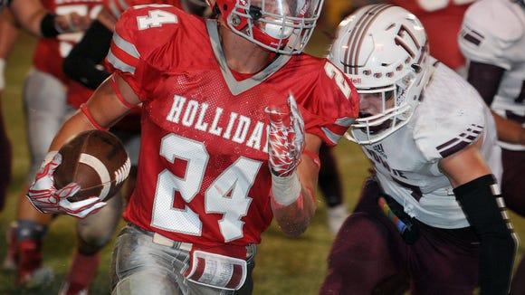 Holliday runningback Tristan Boyd (24) breaks loose