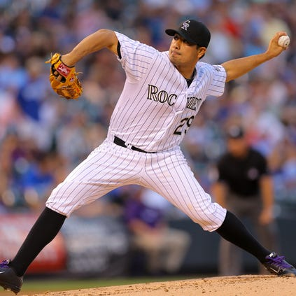 DENVER, CO - AUGUST 20:  Starter Jorge De La Rosa #29 of the Colorado Rockies pitches during the second inning against the Kansas City Royals at Coors Field on August 20, 2014 in Denver, Colorado. (Photo by Justin Edmonds/Getty Images)