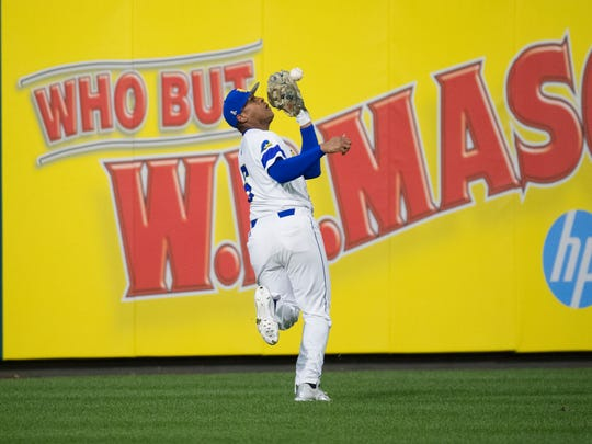 Delaware's Calvin Scott (6) catches a ball deep in left field during the Liberty Bell Classic Championship Tuesday at Citizens Bank Park.
