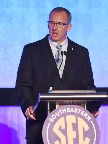 SEC commissioner Greg Sankey talks to the media during