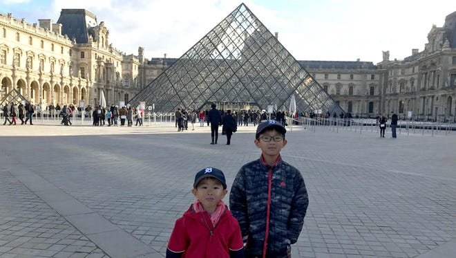 Rob Soon photographs his sons, Rhys and Riley at the Louvre Museum in Paris on a lovely Fall day in late November 2017.