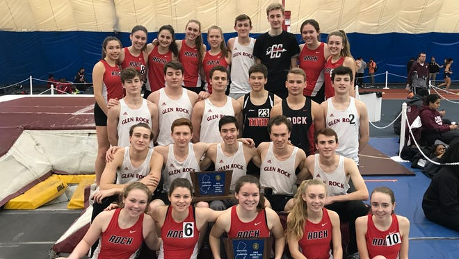The Glen Rock boys and girls after each won North 1, Group 1 indoor track titles.