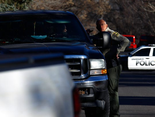 A San Juan County sheriff's deputy directs traffic