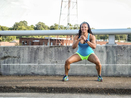 """She doesn't just run, she masters the hill! Walking hill squats fully engage the legs and offer extra burn time to the outer thighs. """"I like to set fitness goals,"""" Robinson said. """"I train for events, I like to run 5K's."""""""