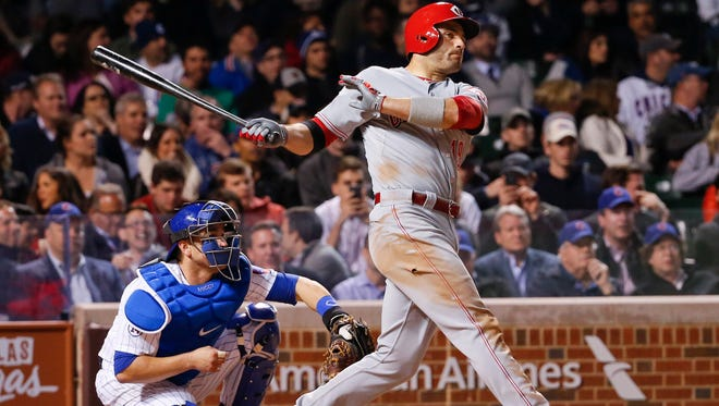 Reds first baseman Joey Votto hits a double against the Chicago Cubs during the fifth inning Tuesday at Wrigley Field.