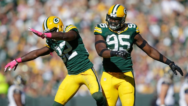Green Bay Packers defenders Chris Banjo and Datone Jones celebrate after Jones blocked a field goal attempt.
