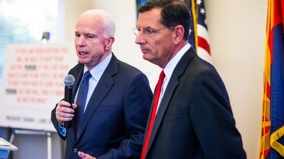 Sen. John McCain, R-Ariz., and Sen. John Barrasso,