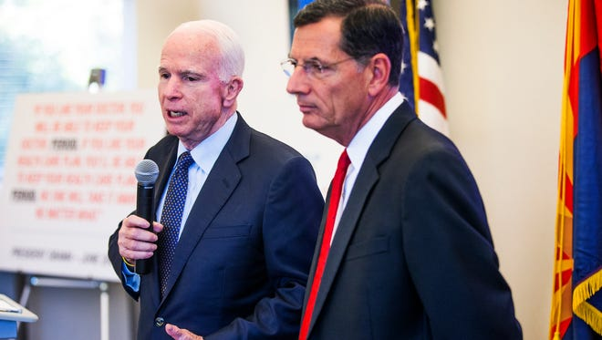 Sen. John McCain, R-Ariz., and Sen. John Barrasso, R-Wyo., right,  conduct a town hall on the Affordable Care Act at the Phoenix Better Business Bureau on Sept. 16, 2016.