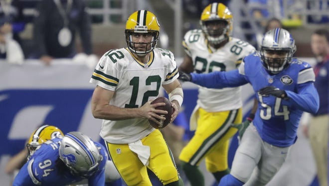 Green Bay Packers quarterback Aaron Rodgers runs for yardage in the third quarter Sunday, January 1, 2017, at Ford Field in Detroit, Mich.