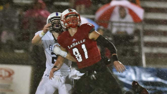 LaSalle's Josh Whyle and Elder's TJ Kearns battle for a deep ball Friday, October 27th at LaSalle High School