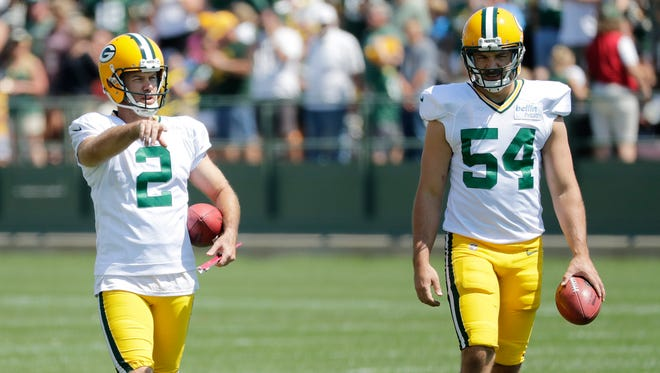 Green Bay Packers kicker Mason Crosby (2) and long snapper Derek Hart (54) walk across the field during training camp practice on Tuesday, August 8, 2017, at Ray Nitschke Field.