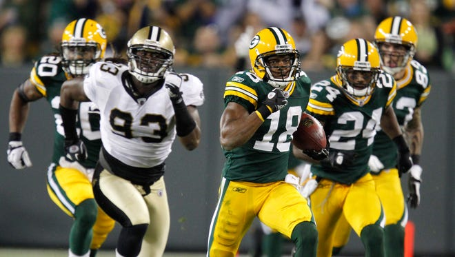 Packers receiver Randall Cobb returns a kick 108 yards for a touchdown against the Saints during the 2011 season opener.