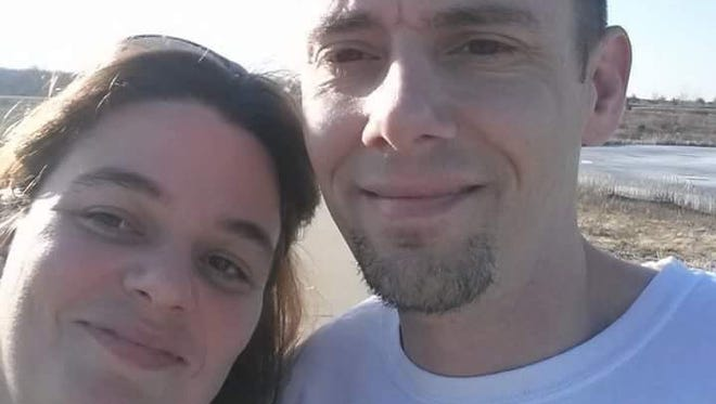 Robert Wilson, 37, right, was shot and killed after intervening in the mistreatment of an animal in Smyrna on Friday evening, according to Smyrna Police. He is pictured with his fiancee Sue Hoskins.