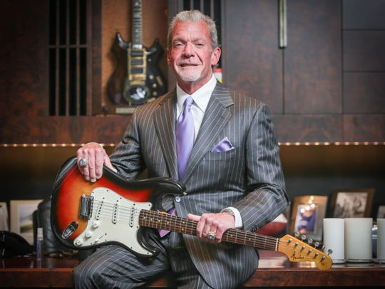 In this 2014 photo, Jim Irsay holds the Fender Stratocaster
