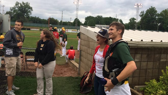 """Dusty Thompson, right, caught the ceremonial first pitch from girlfriend Kristen Bogue before Saturday's Richmond RiverRats baseball game. He then got on one knee and proposed. She said, 'Yes."""""""