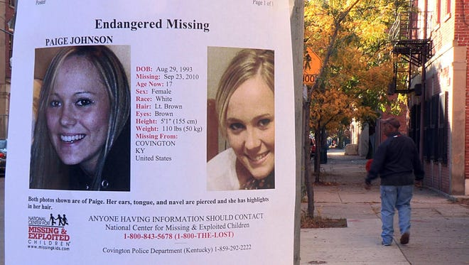 A missing poster for Paige Johnson hung at West 15th and Race streets in Over-the-Rhine in October 2010, one month after the teen disappeared.