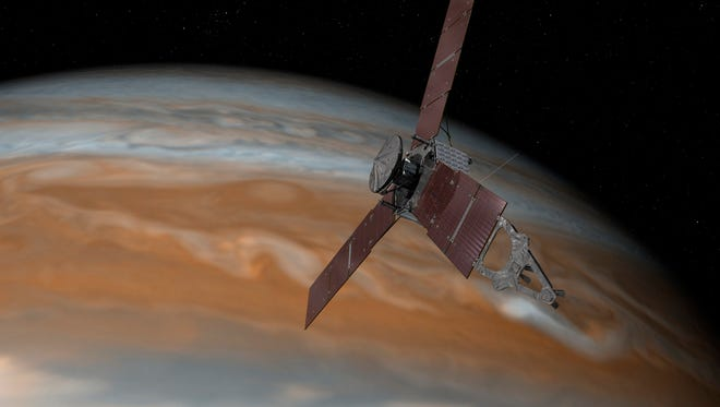 This artist's rendering made available by NASA/JPL-Caltech on July 7, 2015, shows the Juno spacecraft above Jupiter. The spacecraft is scheduled to arrive at the planet on July 4, 2016, to begin a nearly year-long study of the gas giant.