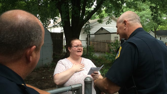 Green Bay Police Officer Mike Francois surprised an east side resident with a $100 gift card donated by Broadway Automotive.