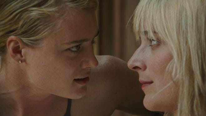 Mackenzie Davis (left) and Caitlin FitzGerald in a scene from the film.