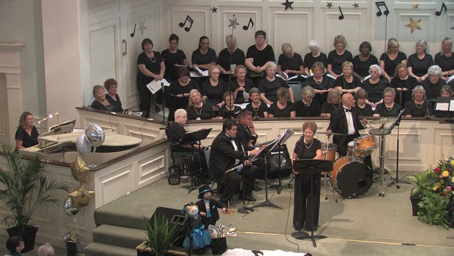 Harriet Yemm, president of the Treasure Coast Chorale, solos with the chorale in a recent concert.