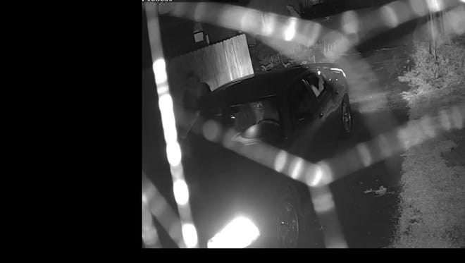 A surveillance image released Monday, May 22, 2017, shows a suspect and vehicle in a May 2 arson at the former Monon Shops warehouse in Lafayette.