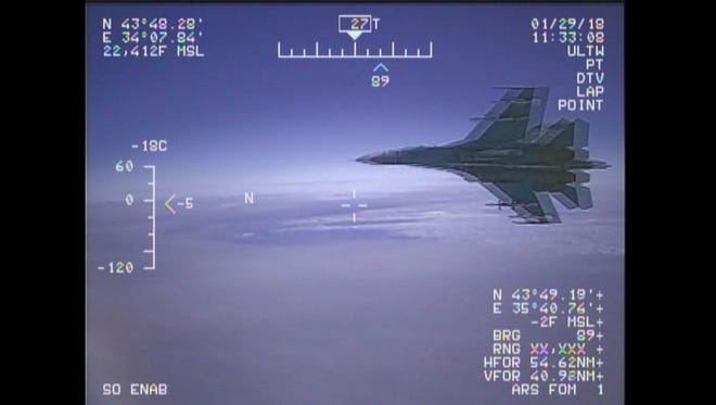 A frame grab taken from a handout video provided by the U.S. Navy shows the view from a U.S. EP-3 Aries aircraft being intercepted by a Russian SU-27 fighter jet in what the Pentagon claims was international airspace over the Black Sea, on Jan. 29.