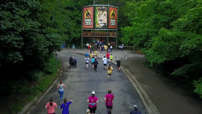 Runners head for the entrance of Binder Park Zoo during the Cheetah Chase 5K run/walk on Saturday, June 23, 2018.
