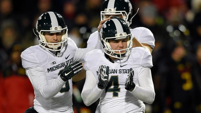 Michigan State place kicker Michael Geiger (4) celebrates his field goal with holder Mike Sadler, left, during the first half of an NCAA college football game against Maryland, Saturday, Nov. 15, 2014, in College Park, Md.