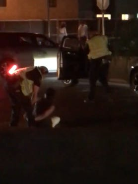 A video recorded by a bystander shows a Tempe police officer dragging a screaming woman from her car on the Fourth of July.